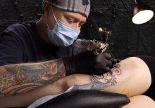Masked Tattoo Artist