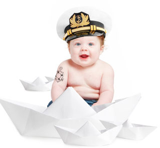 Baby in a Sailor hat showing his