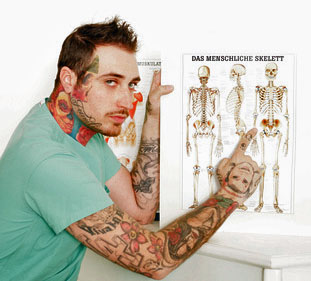 Tattooed doctor showing anatomy chart